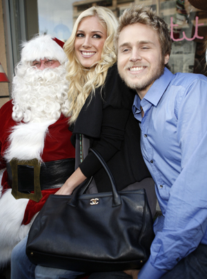 Heidi and Spencer share Christmas cheer with Santa