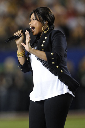 Jennifer does the star spangled banner proud at the Super Bowl