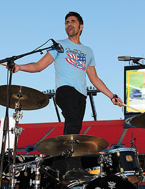 John Stamos on the drums