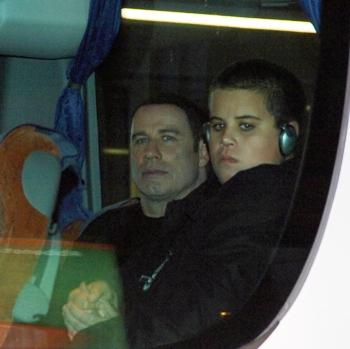 John Travolta and Jett on one of John's planes