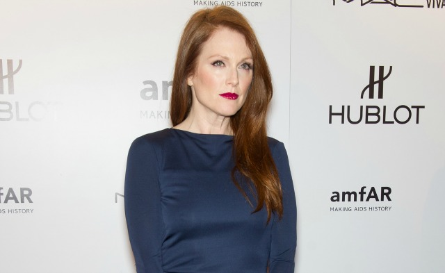 Julianne Moore with red hair and navy dress