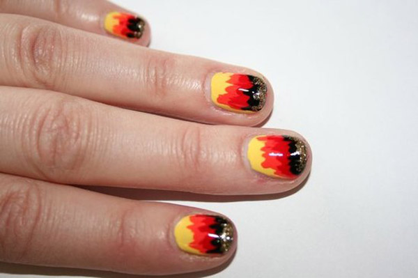 The Hunger Games Girl on Fire manicure by Butter London