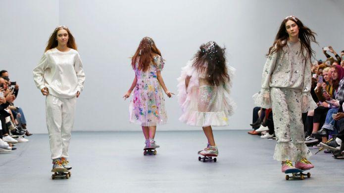 Models skate down the catwalk at