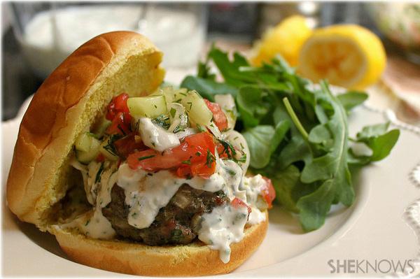 Lamb burgers with feta-yogurt sauce and cucumber, tomato, onion, dill salad