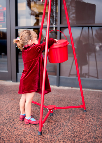 Little girl making a donation