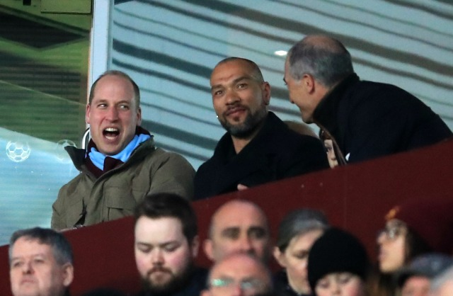 Prince William watches a soccer game with friends on Tuesday night.