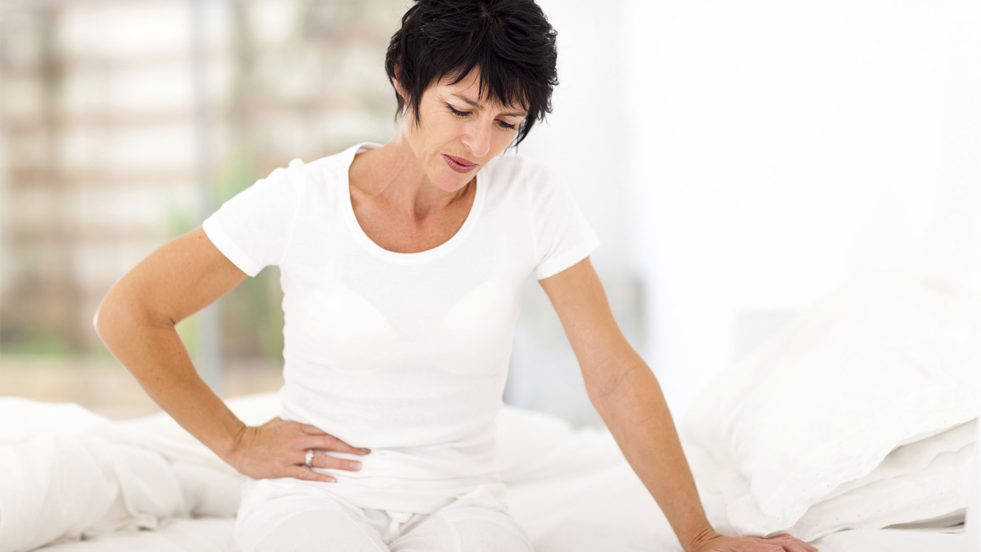 Mature woman having aches and pain