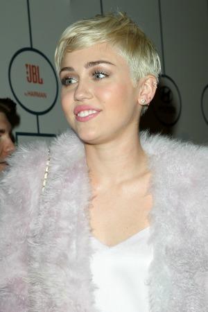 MileyCyruspinkcoat