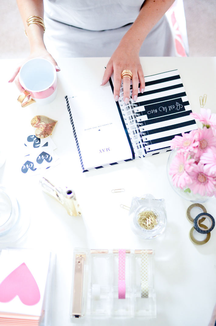 White desk with black and white planner