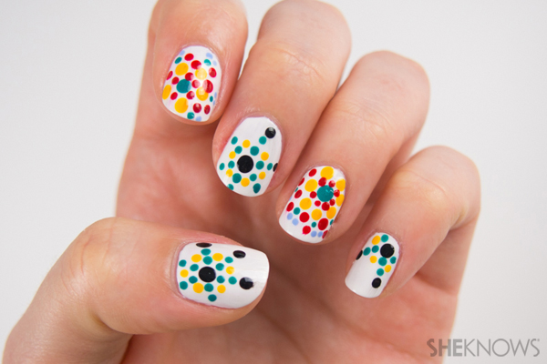 Begin with a white base coat and let dry. 2 Start the design on one nail, using turquoise as the middle and dotting yellow around it. Continue in a circular pattern, adding more layers of color around the design, with some small and some large dots. 3 Continue with more designs on the other nails. You can use the same colors and patterns for three of the nails and the other set of colors and pattern for two of the nails. Let dry and finish with a top coat. You can use this pattern and colors or look at other Moroccan designs for design inspiration.