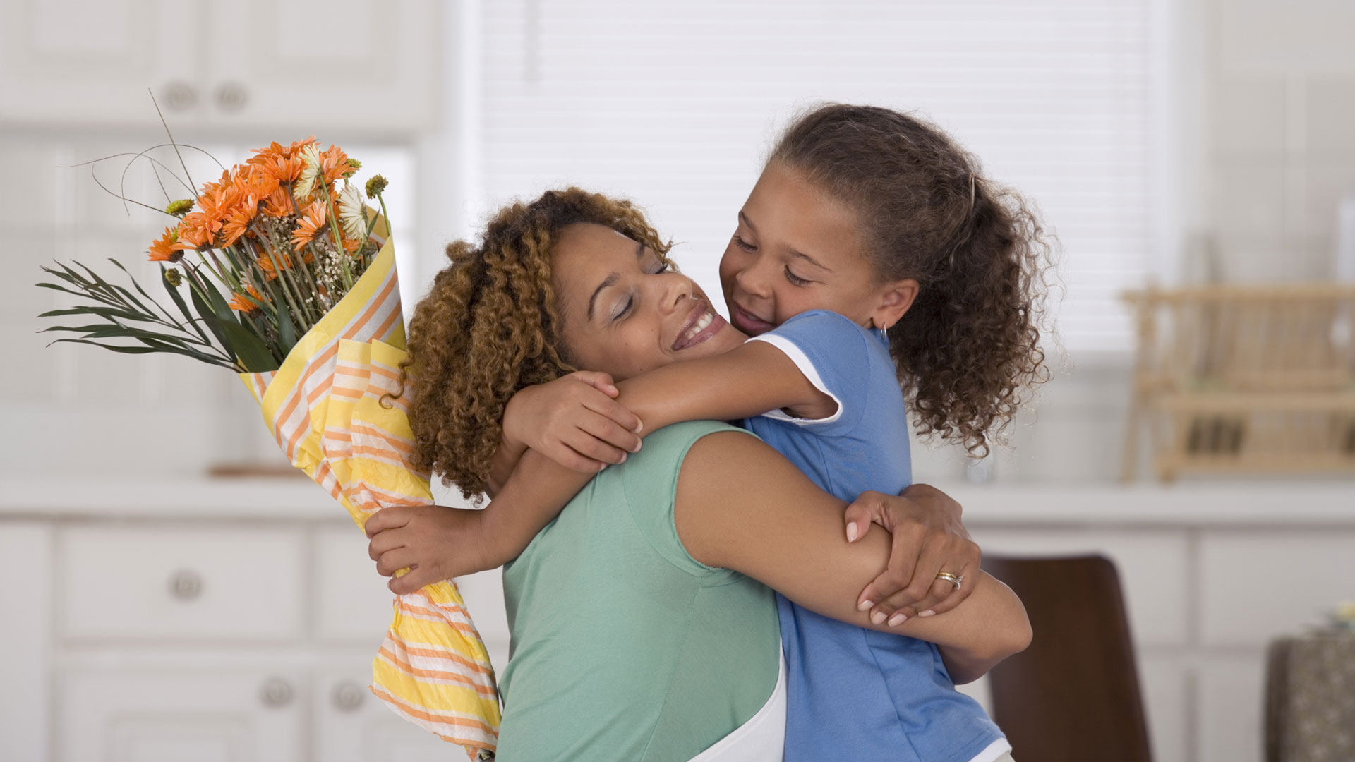 Mother hugging Daughter