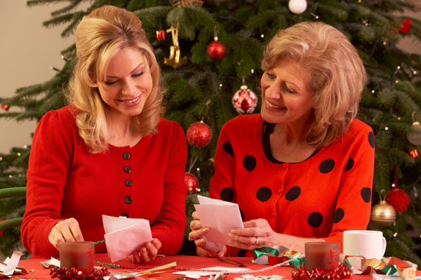 Mother and daughter reading holiday cards