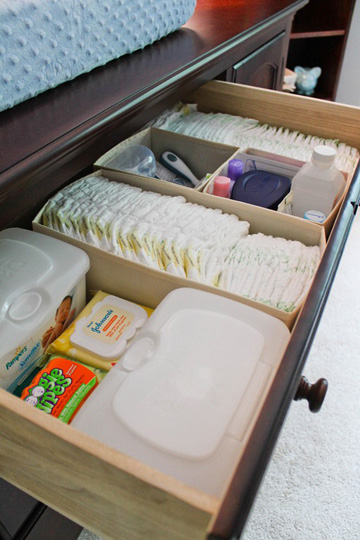 Drawer organizers can help keep diaper gear organized in the dresser.