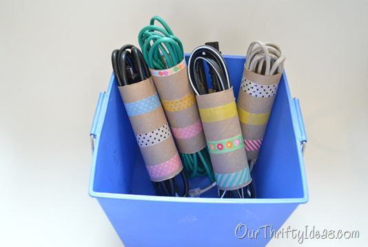 Use old toilet paper rolls to organize your cords.