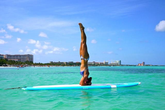 Paddleboard yoga at ocean's edge – Aruba