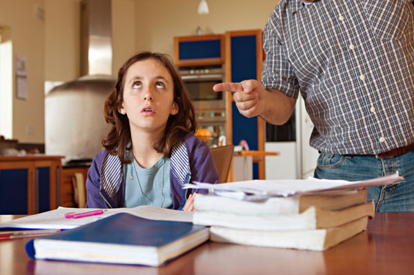 Parent lecturing daughter about school work