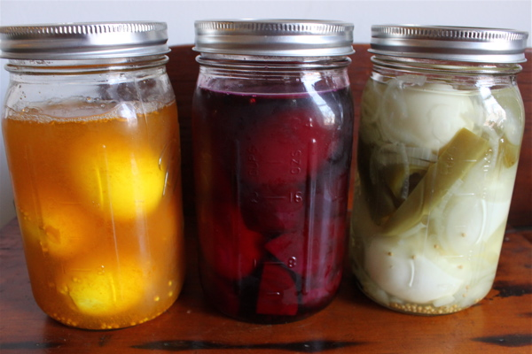 Eggs pickling in colorful brines