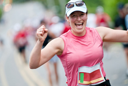 Woman with positive attitude running a marathon