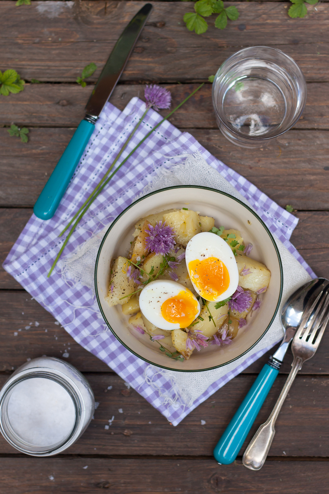 potato salad with chive flowers and soft boiled egg
