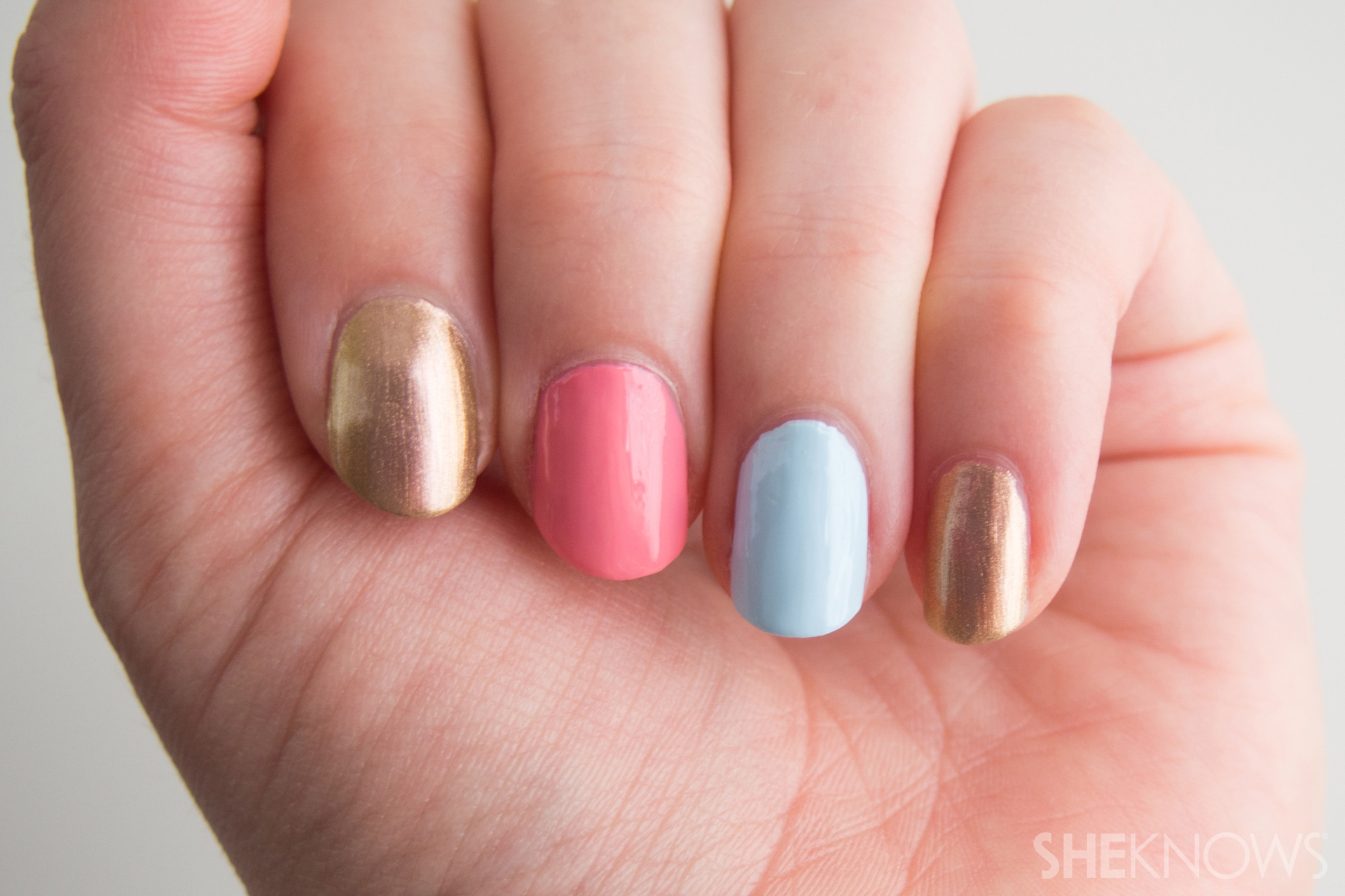Hand with painted nails in different colors