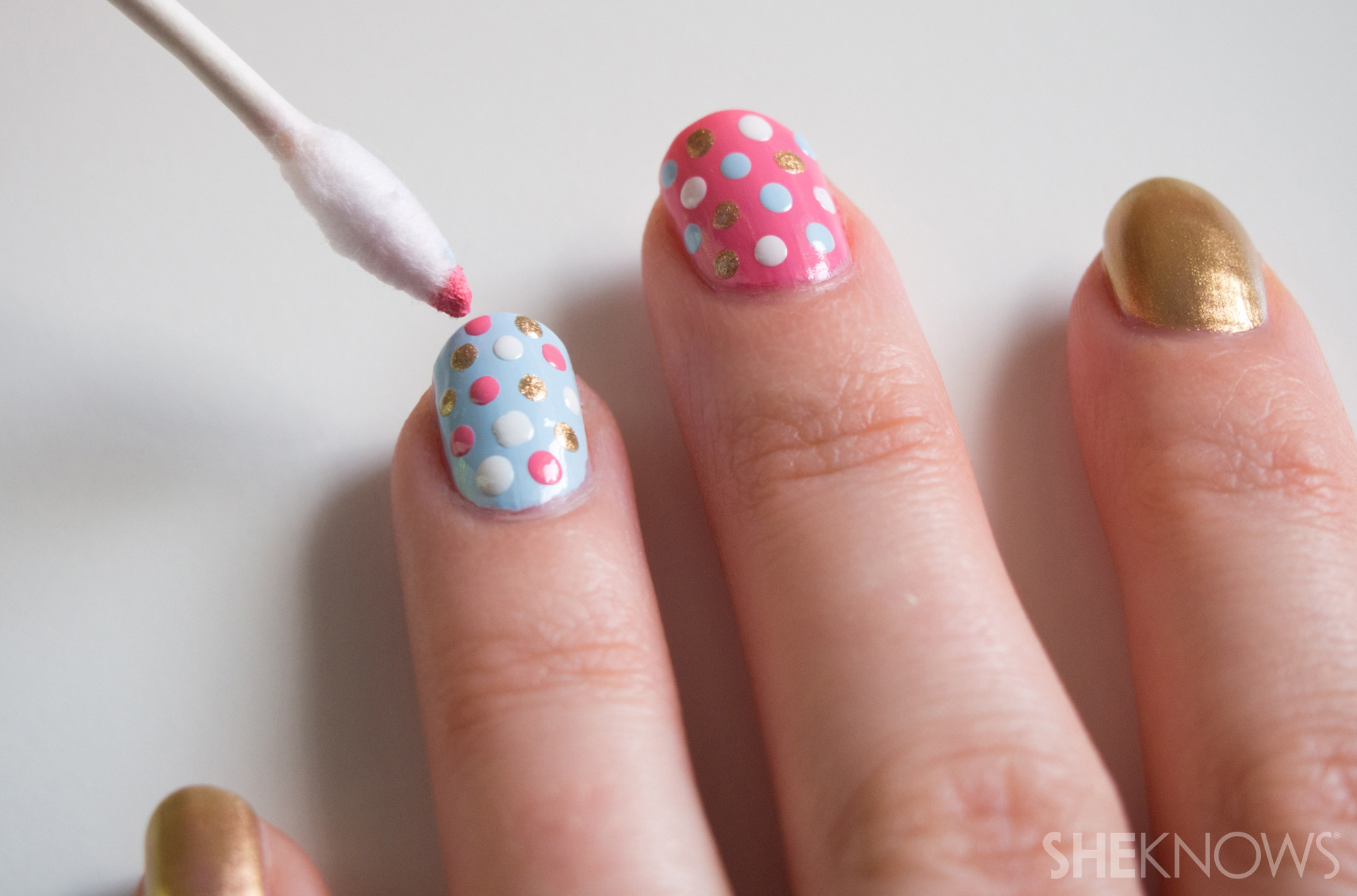 Use a top coat to protect your polka dot nails