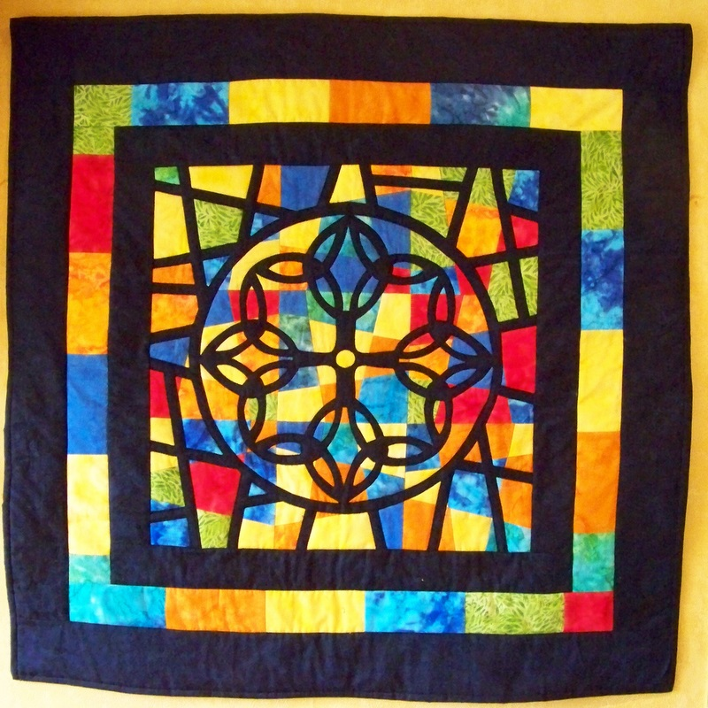 Kennedy uses American quilting techniques, such as Stained Glass Windows, in many of her pieces.