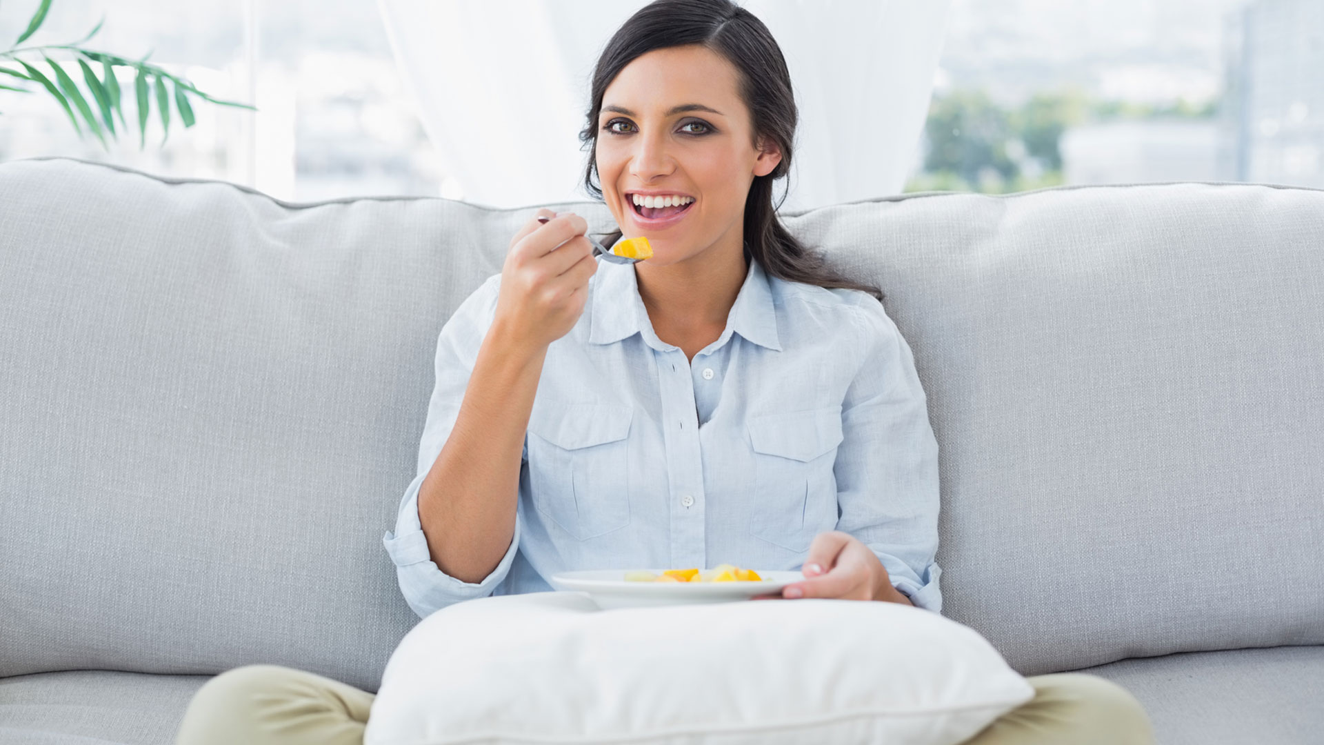 Relaxed woman eating