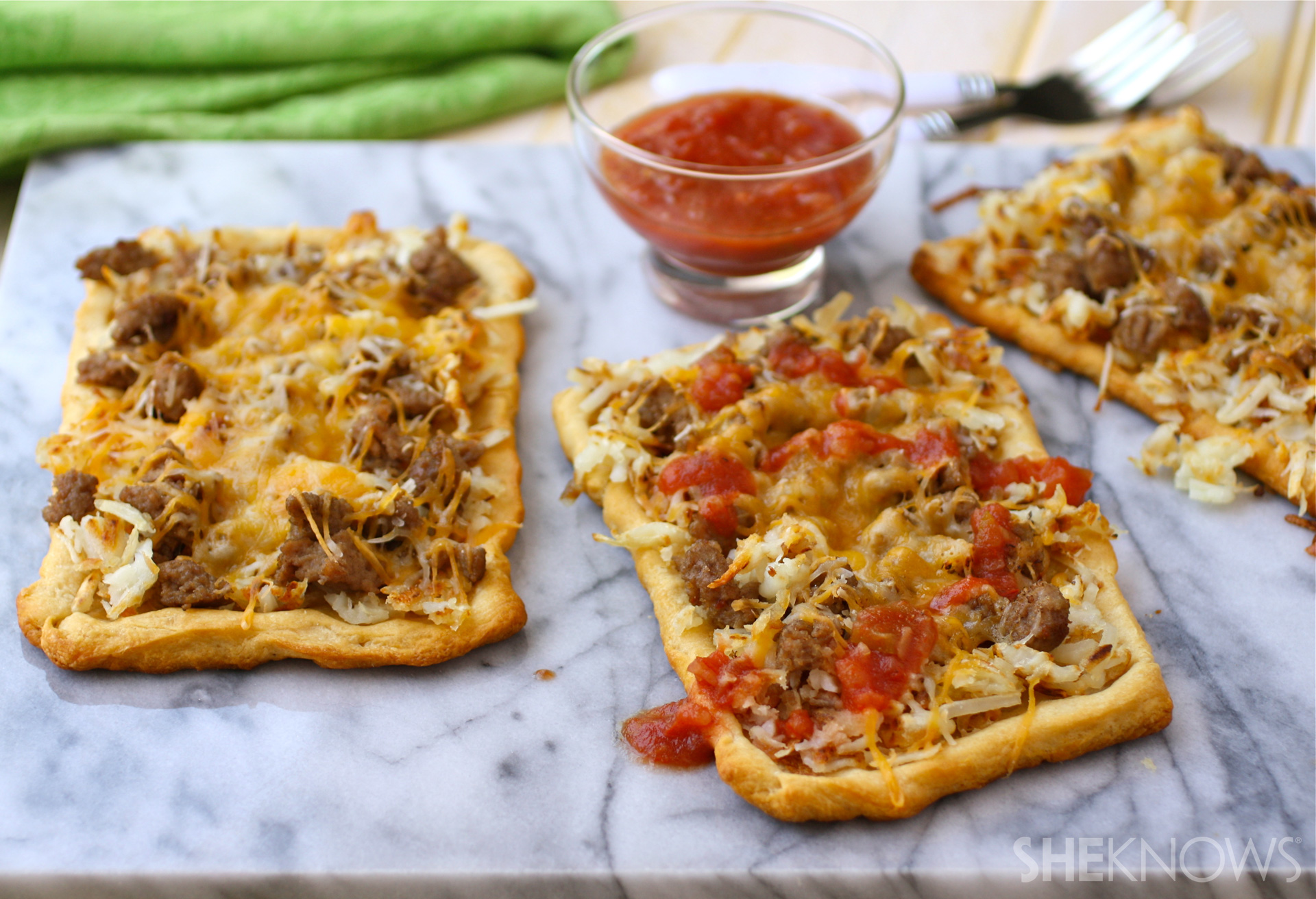 Cheesy sausage and hash brown pizza