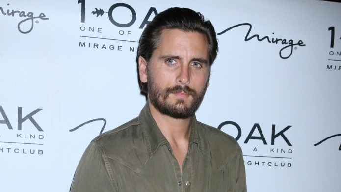 Scott Disick spotted getting handsy with