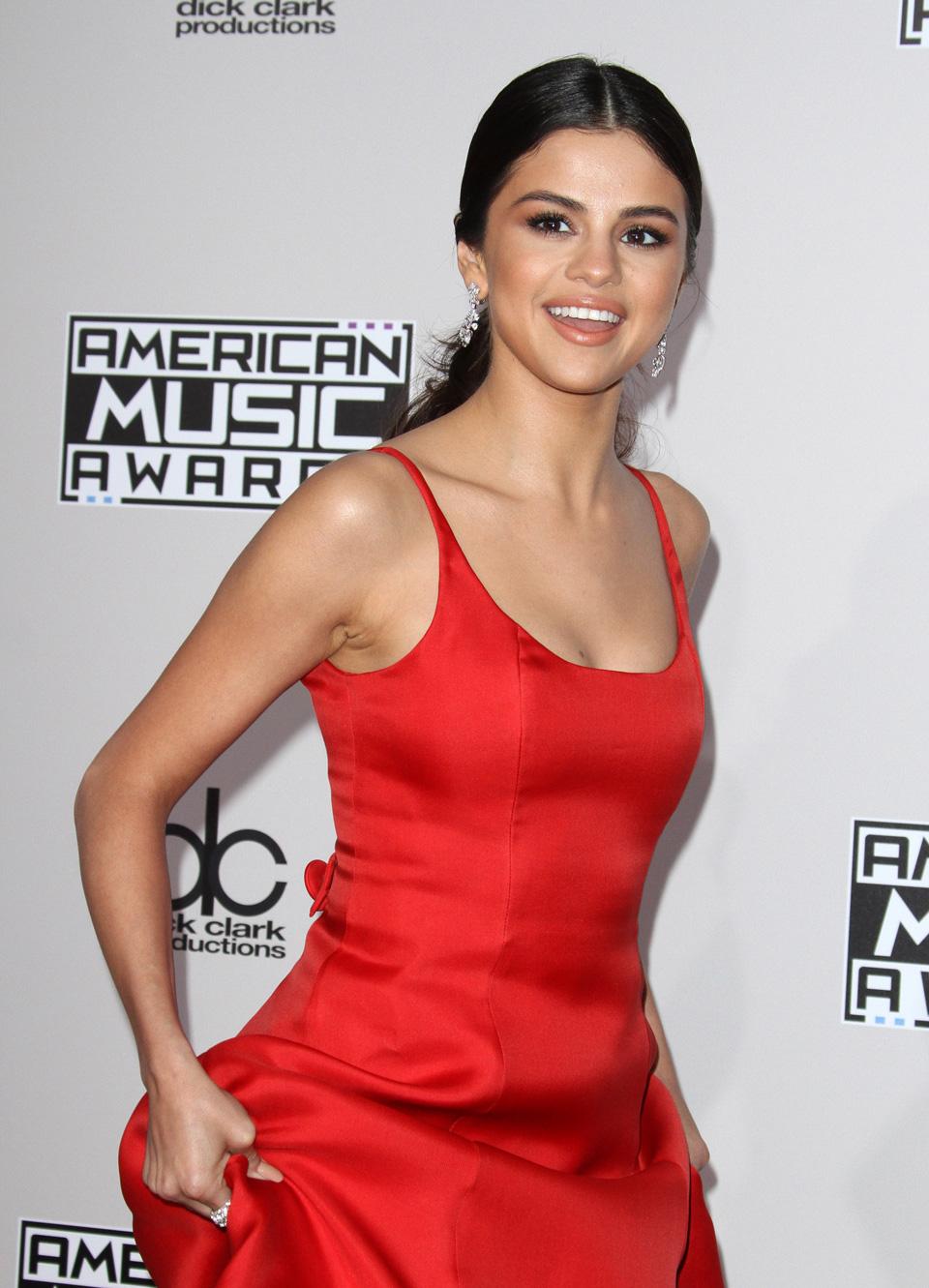 Selina Gomez in red dress smiling