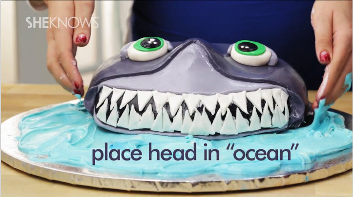 Place the shark cake on an ocean of blue frosting