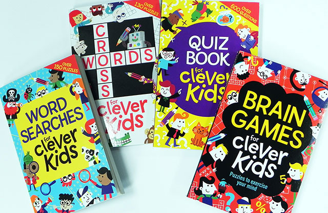 Four activity books for children on a blue background