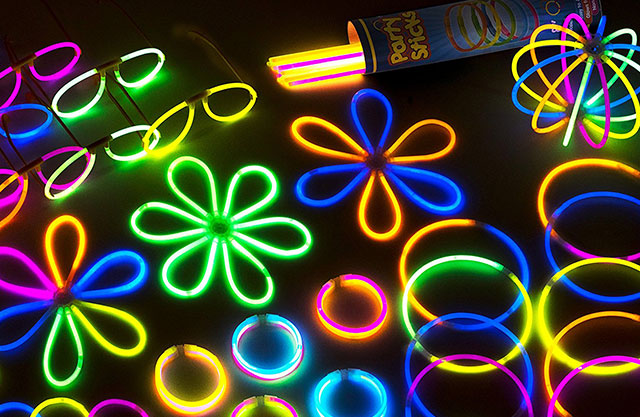 Glow sticks formed into glasses, flowers, and bracelets