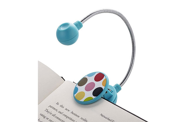 Blue kids' reading light with multi-colored polka dots on a white background