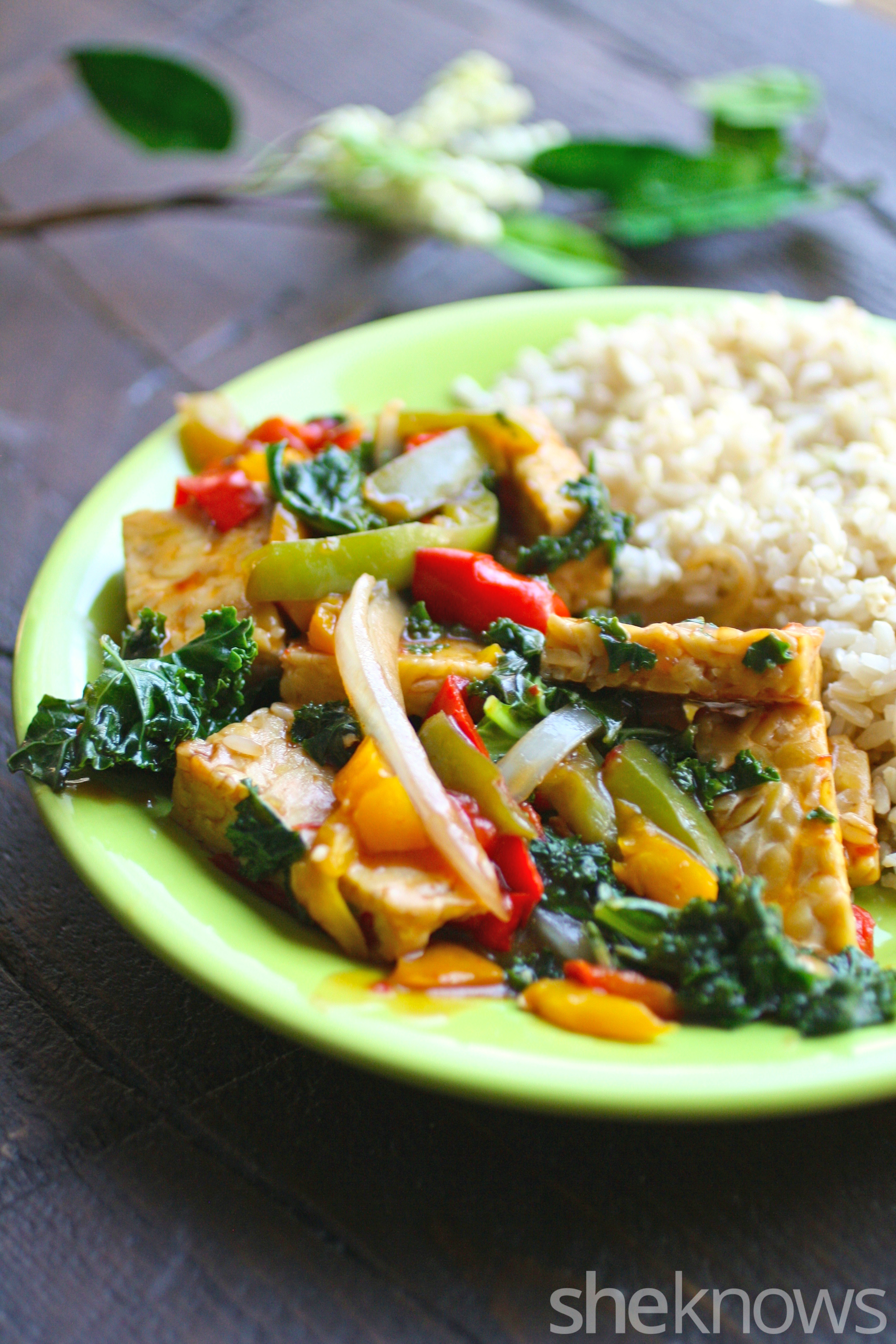 A plate of Szechuan vegetables and tempeh stir-fry with brown rice makes a quick and tasty meal.