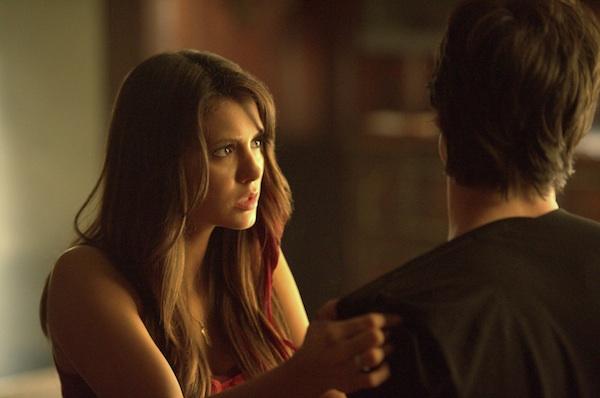 Elena looks at Damon in The Vampire Diaries