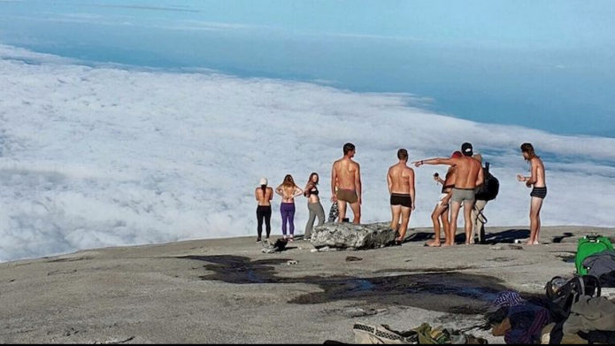Woman's topless pic on a mountain