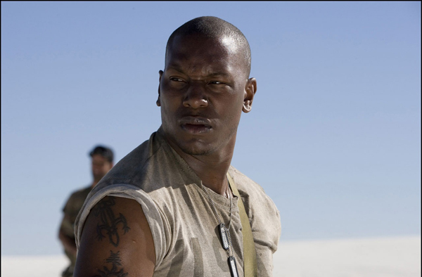 Tyrese looks concerned in Transformers. Currently, Gibson's filming the sequel