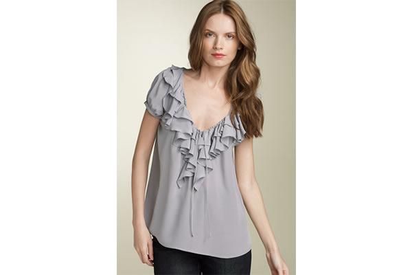 trendsetting mom in ruffled shirt