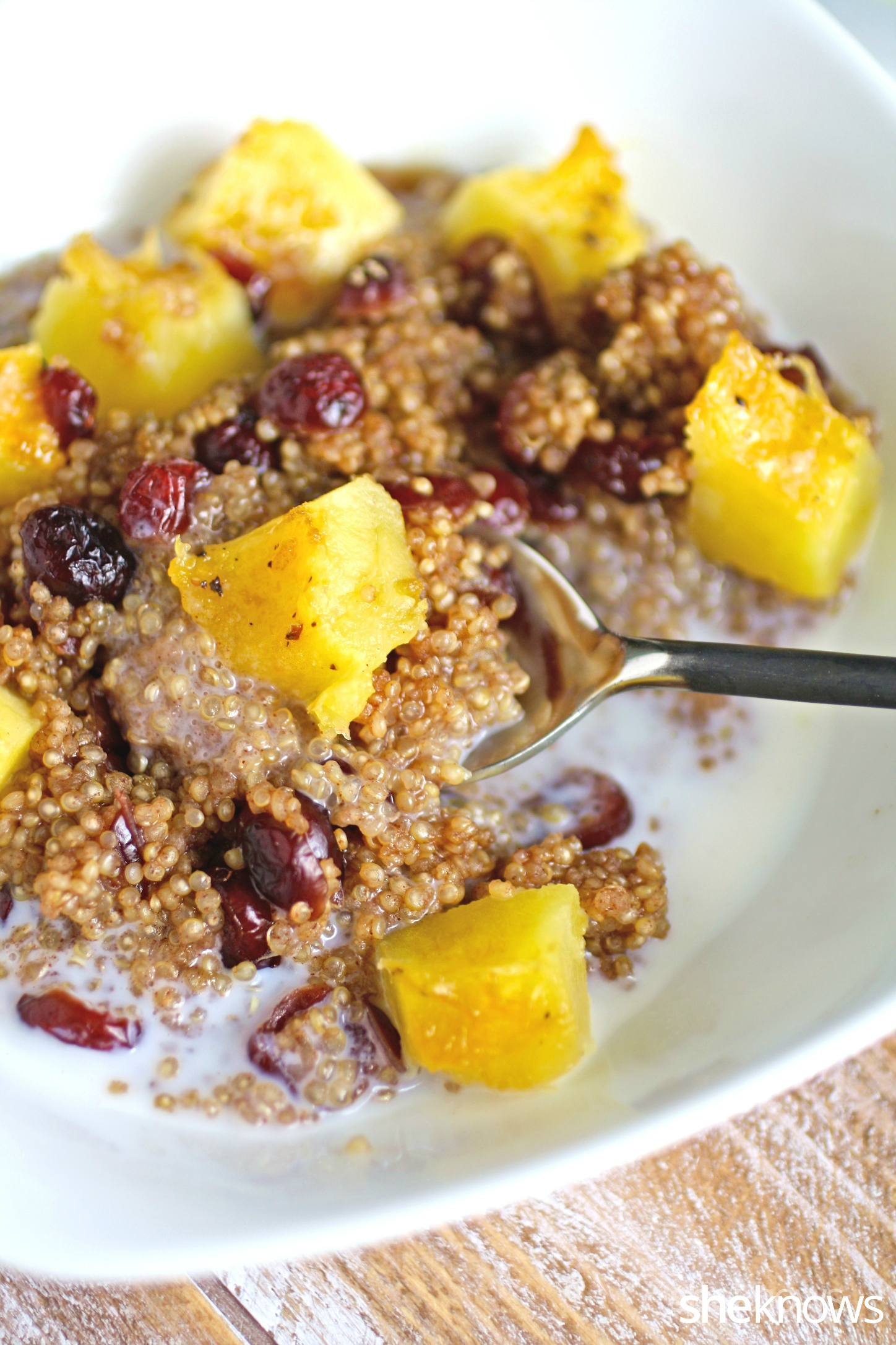 Sit down to breakfast with creamy cinnamon quinoa and acorn squash breakfast bowl