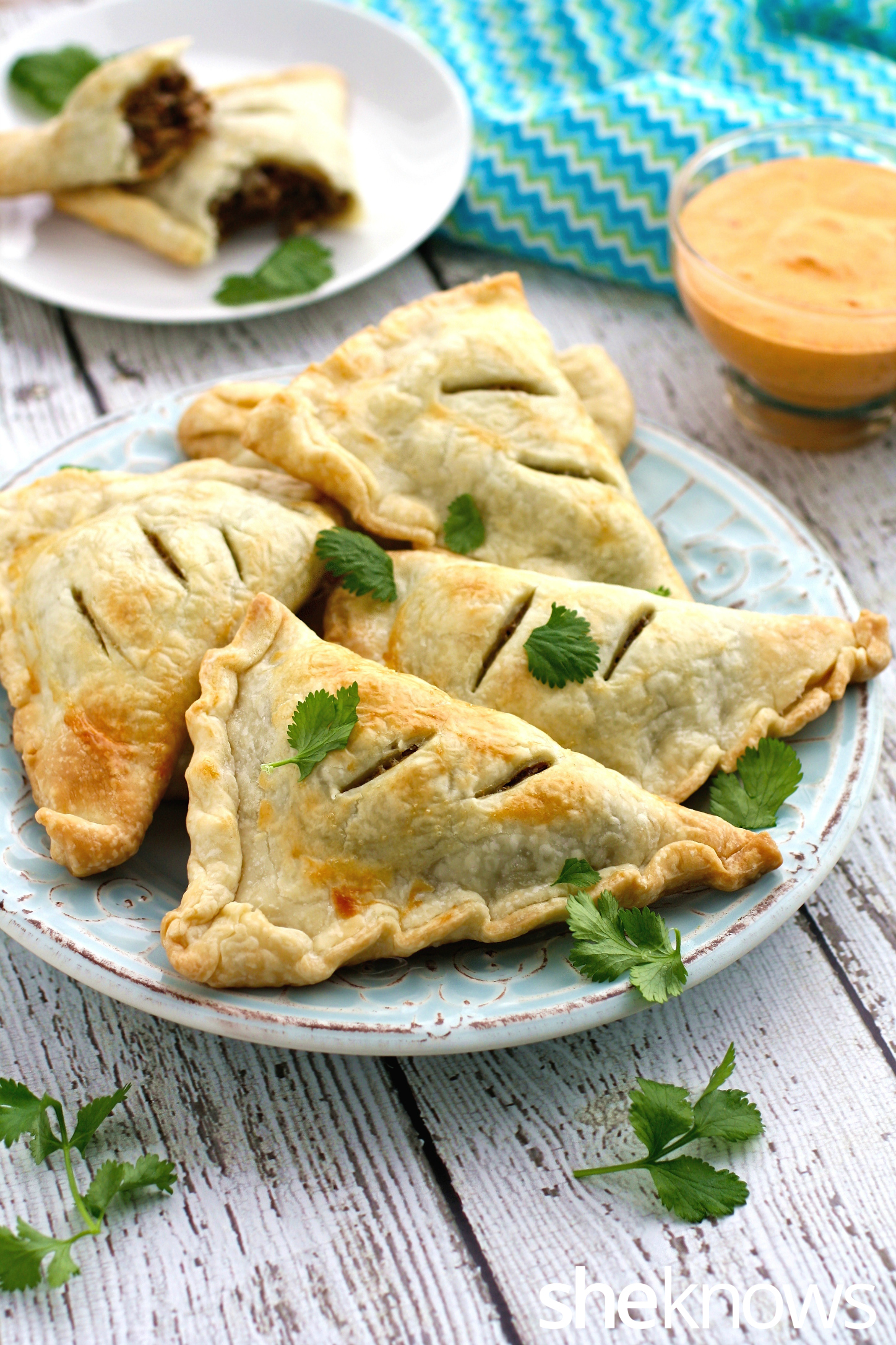 Serve a platter of these fun and filling lentil and mushroom empanadas with creamy roasted red pepper sauce