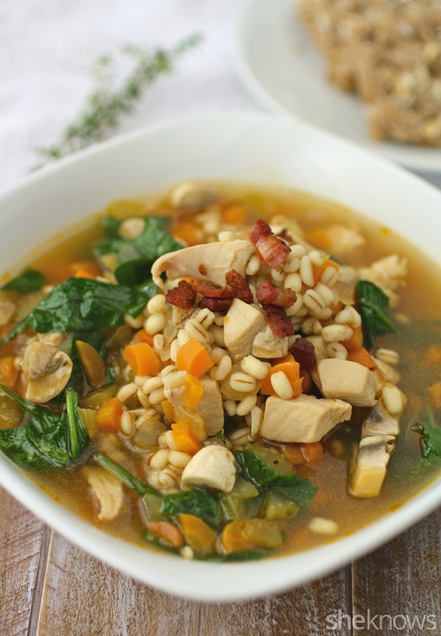 Serve this one-pot chicken and barely soup with spinach and pancetta for dinner