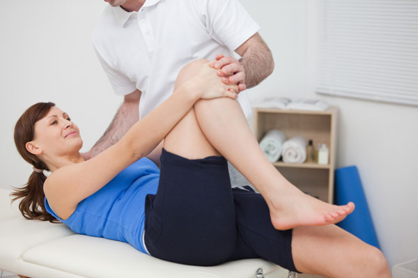 Woman getting physical therapy for knee pain
