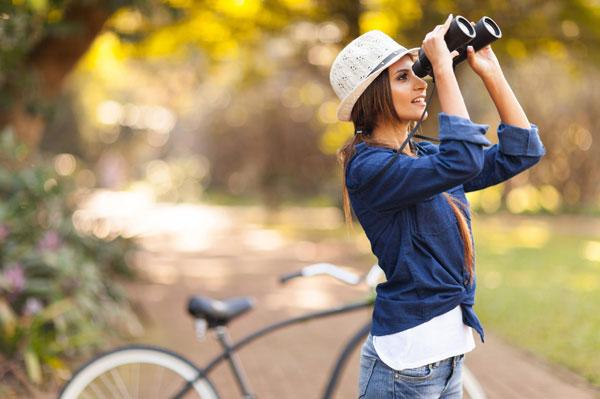 Woman in denim outfit bird watching
