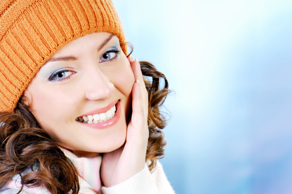Woman in winter wear with nice skin
