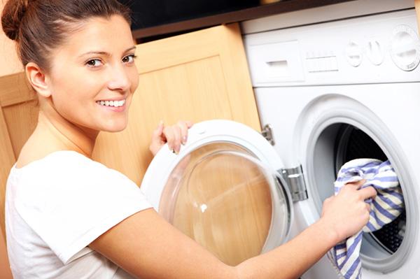 Woman loading her washing machine