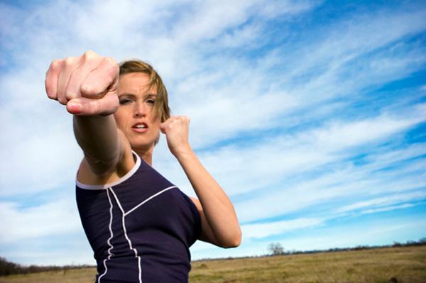 Woman practising self-defense
