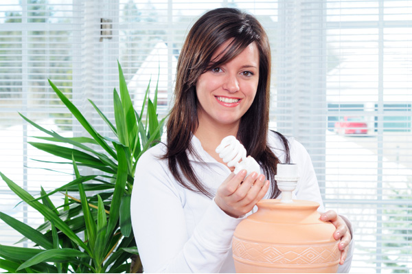Woman installing an eco friendly light bulb