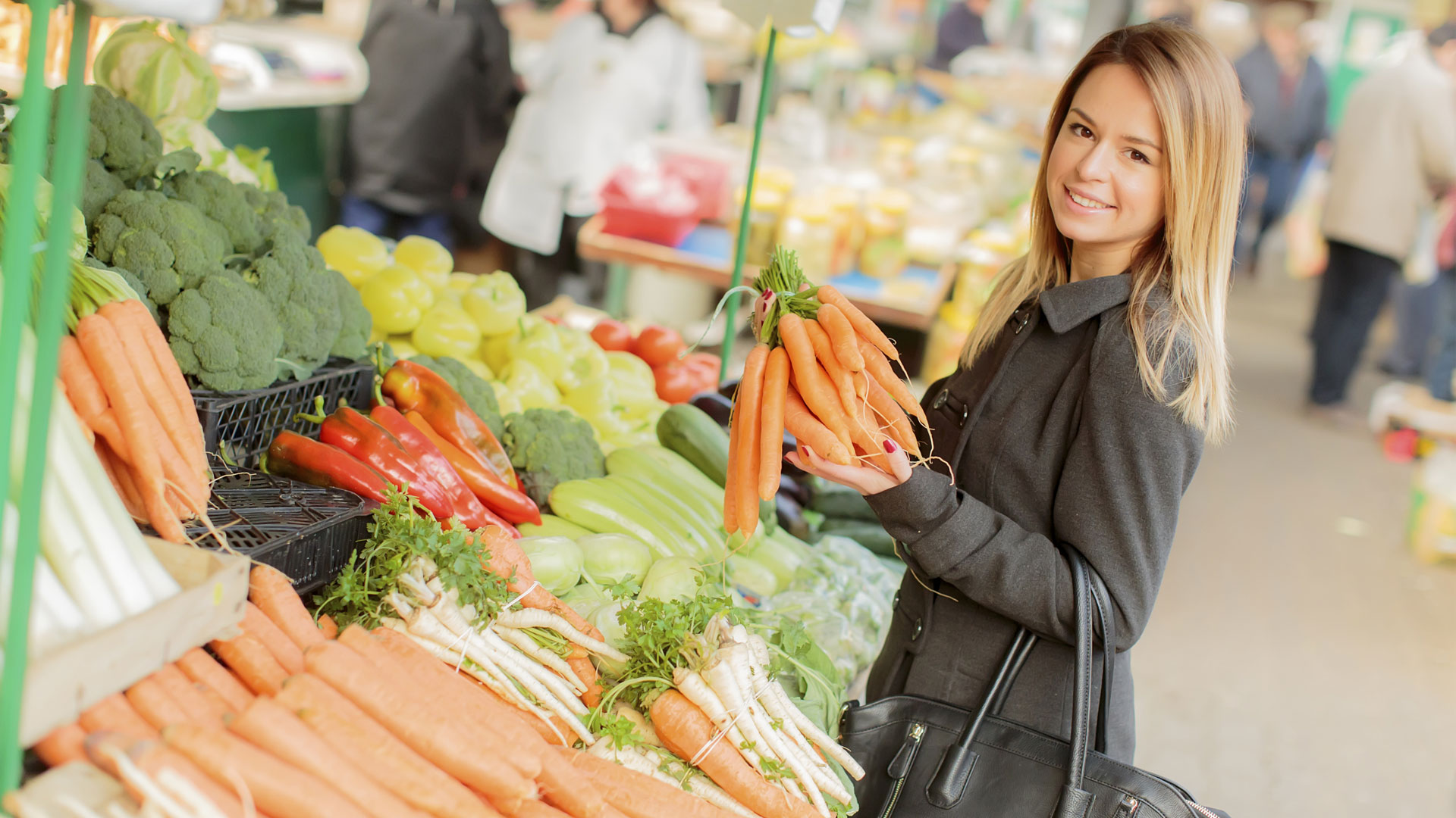 Woman shopping for organic vegetables