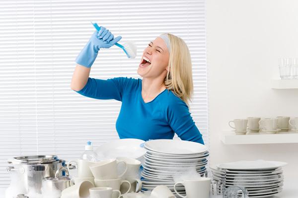 Woman singing into her scrub brush